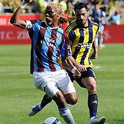 Trabzonspor's Rigobert Song BAHANAG (L) and Fenerbahce's Daniel Gonzalez GUIZA (R) during their Turkey Cup final match Trabzonspor between Fenerbahce at the GAP Arena Stadium at Urfa Turkey on wednesday, 05 May 2010. Photo by TURKPIX