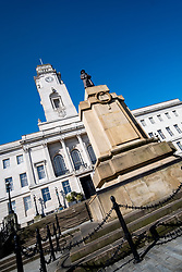 Barnsley Town Hall and war memorial deserted half way through the UK's third week of emergency measures which were announced Monday the 23rd April <br /> <br /> At a regular intervals a public address system remind people they should stay at home - only leave the house for very limited purposes:<br /> shopping for basic necessities, and medicine. <br /> One form of exercise a day.<br /> Any medical need.<br /> Travelling for work purposes, but only where you cannot work from home.<br /> Time spent outside should be minimised<br /> and people should keep a safe distance of 2 meters apart from anyone outside of your household.<br /> <br /> 08 April 2020<br /> <br /> www.pauldaviddrabble.co.uk<br /> All Images Copyright Paul David Drabble - <br /> All rights Reserved - <br /> Moral Rights Asserted -