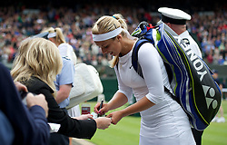 02.07.2012, Wimbledon, London, ENG, WTA Tour, The Championships Wimbledon, im Bild Sabine Lisicki (GER) signs autographs after winning the Ladies' Singles 4th Round match during day seven of the WTA TourWimbledon Lawn Tennis Championships at the All England Lawn Tennis and Croquet Club, London, Great Britain on 2012/07/02. EXPA Pictures © 2012, PhotoCredit: EXPA/ Propagandaphoto/ David Rawcliff..***** ATTENTION - OUT OF ENG, GBR, UK *****