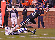 Virginia tight end Joe Torchia (83) leaps over Duke defensive end Jeremy Ringfield (18) for a touchdown during an ACC football game Saturday in Charlottesville, VA. Duke won 28-17. Photo/Andrew Shurtleff