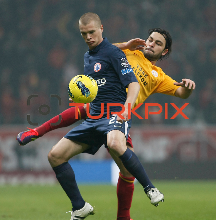 Galatasaray's Selcuk Inan (R) and IBBSpor's Samuel Holmen (L) during their Turkish Super League soccer match Galatasaray between IBBSpor at the TT Arena at Seyrantepe in Istanbul Turkey on Tuesday, 03 January 2012. Photo by TURKPIX