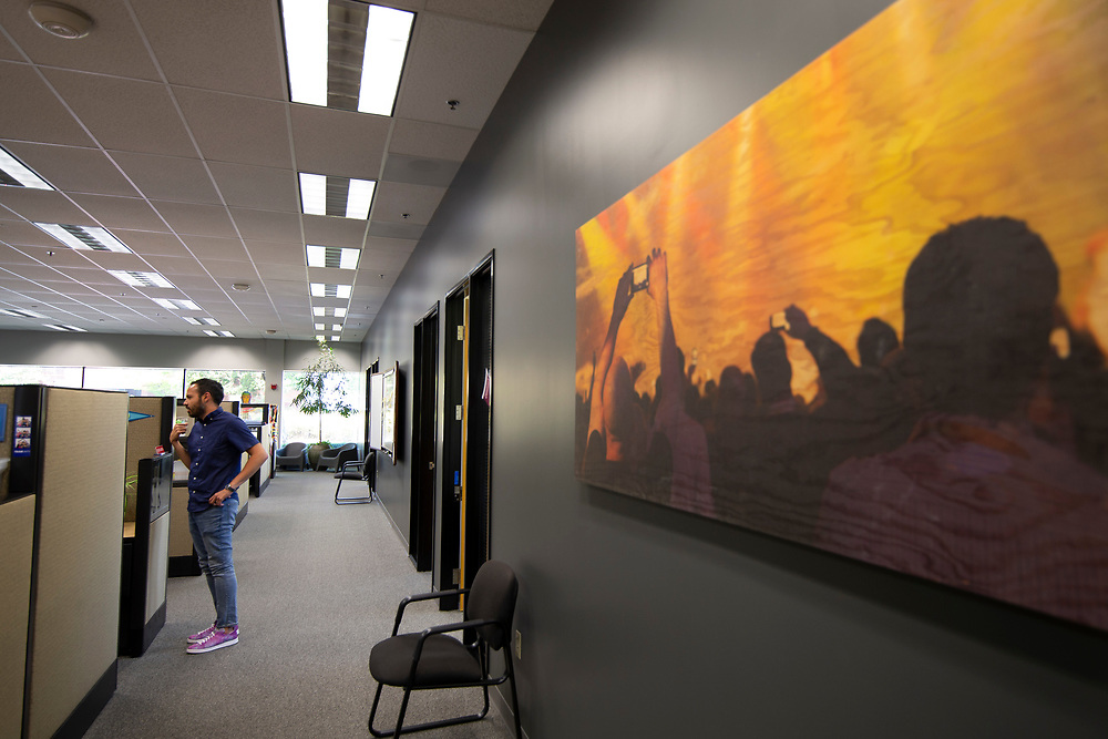 Opus Agency is a winner in The Oregonian/OregonLive's 2018 Top Workplaces competition. Andrew Reyna, Legal Coordinator, in the brand events and marketing agency's Beaverton location at 9000 S.W. Nimbus Avenue. Photo by Randy L. Rasmussen