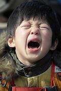 Asian child crying