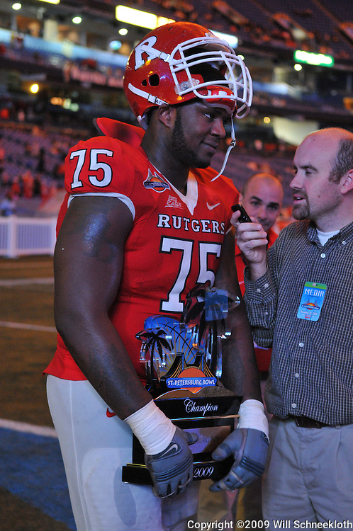 Dec 20, 2009; St. Petersburg, Fla., USA; Rutgers offensive lineman Anthony Davis (75) is interviewed while holding the trophy following Rutgers' 45-24 victory over Central Florida in the St. Petersburg Bowl at Tropicana Field.