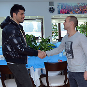 New Signing Wesley Sneijder (C) of Galatasaray with Galatasaray's Gokhan Zan (L) at the Florya Metin Oktay Sports Centert in Istanbul Turkey on Tuesday 22 January 2013. Photo by TURKPIX