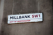 Street sign for Millbank, SW1, City of Westminter, London.