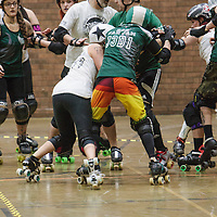 Manchester Roller Derby's Furies and Chaos Engine join forces to take on Wirral Whipiteres' Savage Lillies and Pack Animals in a co-ed bout celebrating 5 years of Manchester Roller Derby held at George H Carnall Leisure Centre, Urmston, 2015-03-07