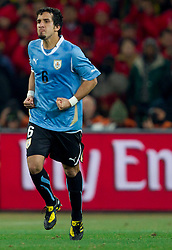 Mauricio Victorino of Uruguay celebrates after he scored  during penalty shots at the  2010 FIFA World Cup South Africa Quarter Finals football match between Uruguay and Ghana on July 02, 2010 at Soccer City Stadium in Sowetto, suburb of Johannesburg. Uruguay defeated Ghana after penalty shots. (Photo by Vid Ponikvar / Sportida)