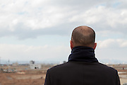 People look out over the tsunami devastated landscape from a  shrine on top of Hiyori yama  or Weather Hill to remember victims of the tsunami at  Miyagi, Japan. Friday March 11th 2016. 2016 marks the fifth anniversary of the Great East Japan earthquake. This magnitude 9 quake caused a tsunami that flattened large parts of the Tohoku coast killing around 18,000 people and triggering a nuclear disaster at Fukushima Daichi Power Station.