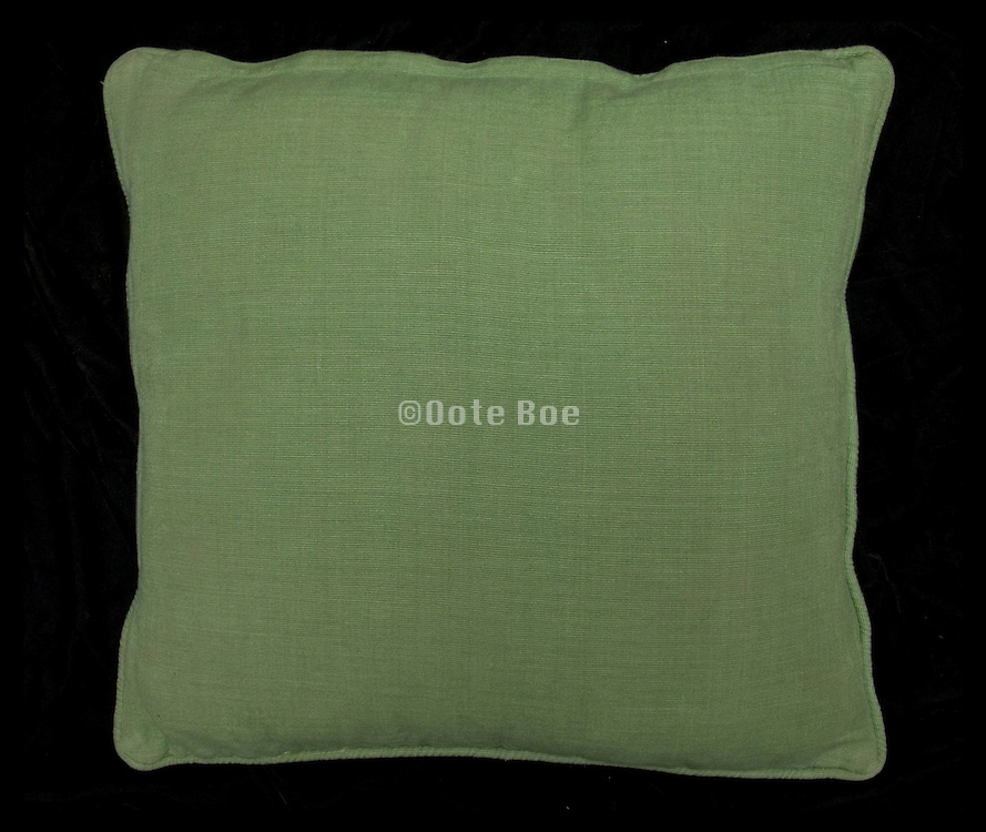 smooth green cushion on a black background