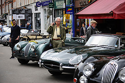 © Licensed to London News Pictures. 17/06/2018. LONDON, UK. A visitor views a 1966 Jaguar E Type Series 1 at the 6th Annual Classic and Supercar Pageant held at St John's Wood High Street.  Traditionally taking place on Fathers' Day, the show brings together an eclectic mix of exotic and popular vehicles attracting visitors young and old and raises funds for the local charity, The St John's Hospice.  Photo credit: Stephen Chung/LNP
