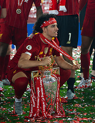 LIVERPOOL, ENGLAND - Wednesday, July 22, 2020: Liverpool's Curtis Jones celebrates with the Premier League trophy and his winners' medal as the Reds are crowned Champions after the FA Premier League match between Liverpool FC and Chelsea FC at Anfield. The game was played behind closed doors due to the UK government's social distancing laws during the Coronavirus COVID-19 Pandemic. Liverpool won 5-3. (Pic by David Rawcliffe/Propaganda)