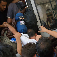 Illegal migrants try to board a train in hopes to leave for Germany at the main railway station Keleti in Budapest, Hungary on September 03, 2015. ATTILA VOLGYI