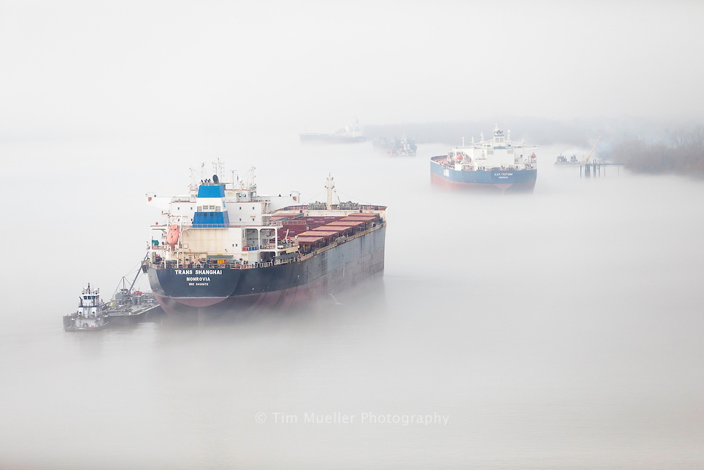 Cargo ships anchor on the foggy Mississippi River near Lutcher, La. The Mississippi River is a natural transportation network with nearly 6,000 vessels and 500 million tons of cargo traveling up and down the river each year.