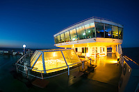 Night view of the deck of one the ferry boats that service the crossing of the Rio de La Plata, between Colonia del Sacaramento in Uruguay and Buenos Aires in Argentina.