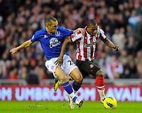 20111226: LONDON, UK - Barclays Premier League 2011/2012: Sunderland vs Everton.<br /> In photo: Leon Osman of Everton FC (L) tussles with Stephane Sessegnon of Sunderland AFC.<br /> PHOTO: CITYFILES