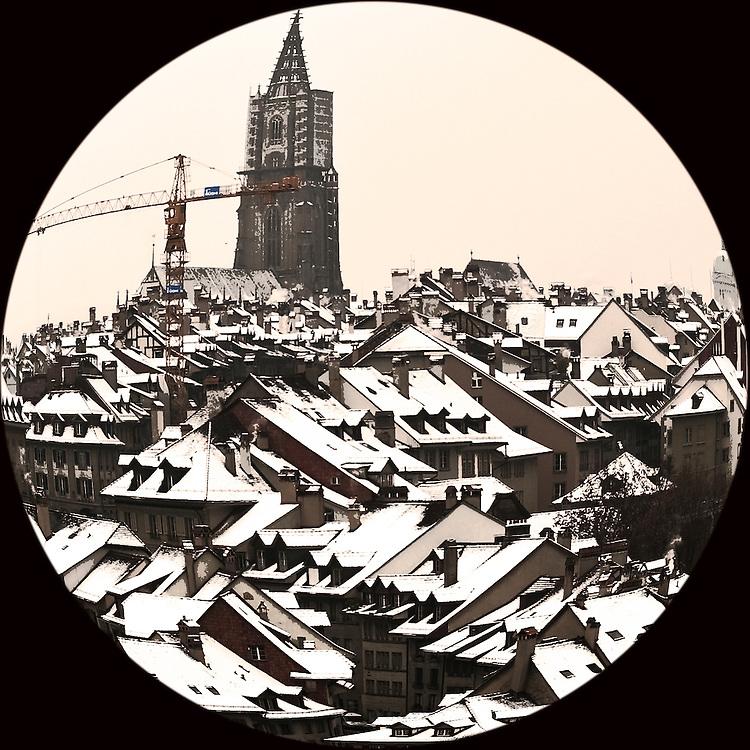 Round winter shot of Bern rooftops