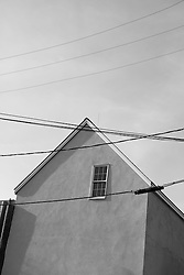 house with one window and power lines in Montauk, NY