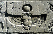 Scarab beetle and vulture wings under disk of the sun. Limestone relief, Edfu.