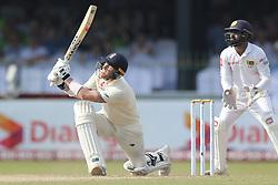 November 23, 2018 - Colombo, Sri Lanka - England cricketer Ben Stokes (L) plays a shot as Sri Lankan wicket keeper Niroshan Dickwella looks on during the 1st day's play in the 3rd and final test cricket match between England and Sri Lanka at SSC international cricket stadium, Colombo, Sri Lanka. 11-23-2018  (Credit Image: © Tharaka Basnayaka/NurPhoto via ZUMA Press)