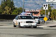 Shooting in San Bernardino.<br /> Local San Bernardino law enforcement rushing off to engage the shooters on San Bernardino Ave.