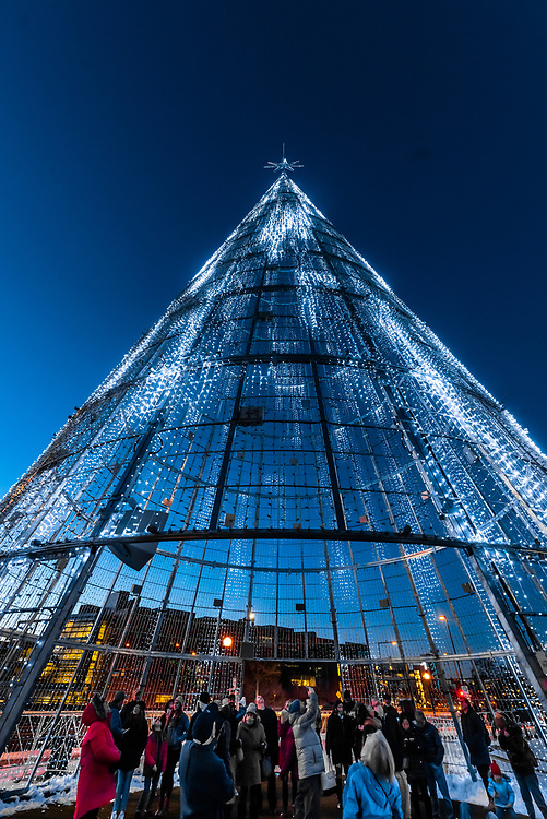 Interior view of the Mile High Tree, a 110 foot tall digital Christmas tree that you can walk inside to watch a sound and light show.  The tree contains 60,000 strands of LED lights. Denver Performing Arts Complex Sculpture Park, Downtown Denver, Colorado USA.