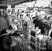Sailors on leave at Fisherman's Wharf buying souvenirs, San Francisco