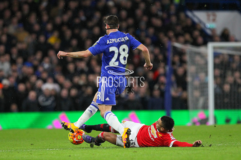 Jesse Lingard of Manchester United tackles Chelsea's Cesar Azpilicueta during the Barclays Premier League match between Chelsea and Manchester United at Stamford Bridge, London, England on 7 February 2016. Photo by Phil Duncan.