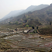 Terraced fields surround the village of Lao chai in the Highlands near Sapa, Northern Vietnam. The highlands are close to the Chinese border, inhabited by highland minorities including Hmong and Dzao groups. Sapa is now a thriving tourist destination for travelers taking the night train from Hanoi. Sapa, Vietnam. 16th March 2012. Photo Tim Clayton