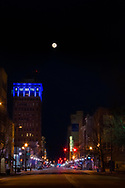 The first full moon of 2018 rises above the city of Huntington, West Virginia looking down town 4th Avenue.