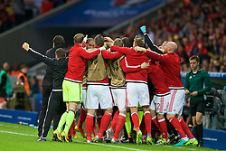 5LILLE, FRANCE - Friday, July 1, 2016: Wales' captain Ashley Williams celebrates scoring his sides first goal, to make the score 1-1, with substitutes and staff during the UEFA Euro 2016 Championship Quarter-Final match  against Belgium at the Stade Pierre Mauroy. (Pic by Paul Greenwood/Propaganda)