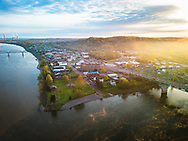 The rising sun casts its glow over the town of Point Pleasant West Virginia viewed from up high where the two rivers of the Kanawha and Ohio meet.