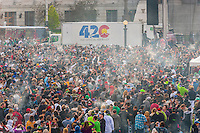 Massive amounts of smoke as the crowd lights up at 4:20 PM, 420 Cannabis Culture Music Festival, Civic Center Park, Downtown Denver, Colorado USA. This is the largest marijuana rally in the world.