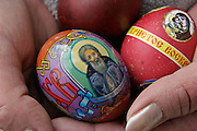 Moscow, Russia, 10/04/2004..Russian Orthodox Easter celebrations at the Church of Peter and Paul in central Moscow. Churchgoerwith decorated easter eggs awaits blessing by Father Vasily.