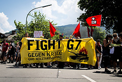05.06.2015, Garmisch Partenkirchen, GER, G7 Gipfeltreffen auf Schloss Elmau, Circa 300 Menschen demonstrieren in Garmisch-Patenkirchen gegen den G7-Gipfel im benachbarten Elmau, im Bild Demoteilnehmer halten ein Transparent // during Protest of the G7 opponents prior to the scheduled G7 summit which will be held from 7th to 8th June 2015 in Schloss Elmau near Garmisch Partenkirchen. Garmisch Partenkirchen, Germany on 2015/06/05. EXPA Pictures © 2015, PhotoCredit: EXPA/ Eibner-Pressefoto/ Gehrling<br /> <br /> *****ATTENTION - OUT of GER*****