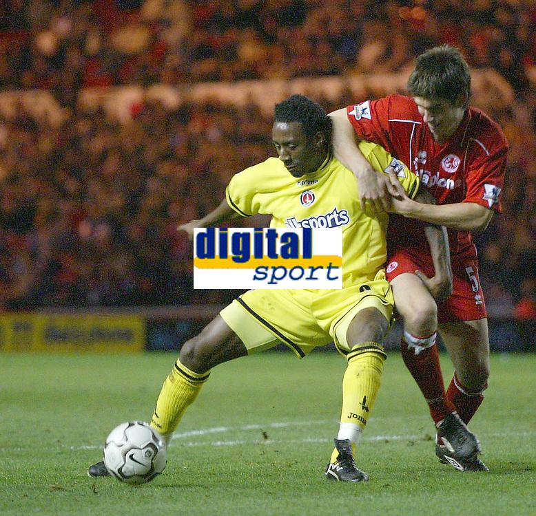Photo. Andrew Unwin.<br /> Middlesbrough v Charlton Athletic, Barclaycard Premier League, Riverside Stadium, Middlesbrough 13/12/2003.<br /> Charlton's Jason Euell (l) holds off Middlesbrough's Chris Riggot (r).