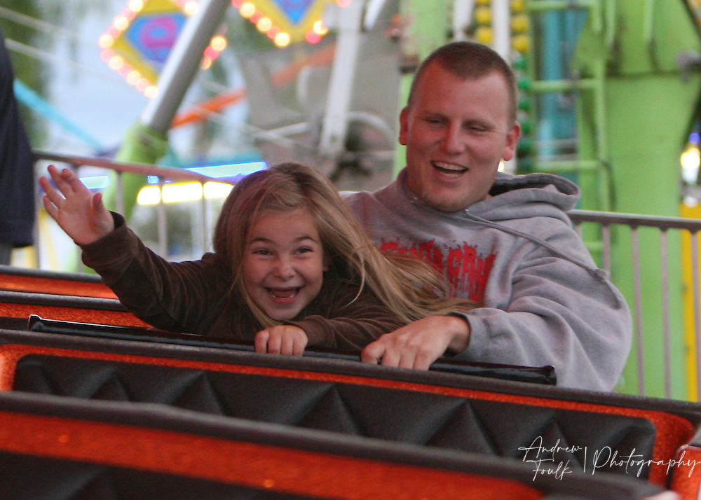 /Andrew Foulk/For The Californian/.Alee Kantor, 7, and her father Jessie, of Hemet, smile and scream as they ride one of the many rides at the Southern California Fair in Perris.