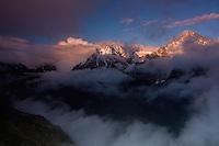 Mount Krivàn (2495 m asl), national symbol of Slovakia. The massif with Mount Hruba Kopa (2238 m asl) and the Kouprova valley in fog at sunset. High Tatras, Slovakia. June 2009. Mission: Ticha