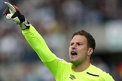 "AFC Bournemouth goalkeeper Asmir Begovic during the Premier League match at The Hawthorns, West Bromwich. PRESS ASSOCIATION Photo. Picture date: Saturday August 12, 2017. See PA story SOCCER West Brom. Photo credit should read: Nick Potts/PA Wire. RESTRICTIONS: EDITORIAL USE ONLY No use with unauthorised audio, video, data, fixture lists, club/league logos or ""live"" services. Online in-match use limited to 75 images, no video emulation. No use in betting, games or single club/league/player publications."