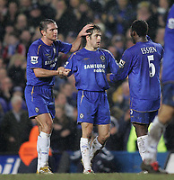 Photo: Lee Earle.<br /> Chelsea v Colchester United. The FA Cup. 19/02/2006. Frank Lampard (L) and Michael Essien (R) congratulate Joe Cole (C) after he scored their third.