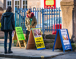 Leith, Edinburgh, Scotland, United Kingdom, 11 April 2019. Leith Walk Council By-Election:  One of the polling stations at Lorne Primary School, with SNP activist Shaun, and Scottish Green activist Jenny waiting to greet voters. The election is taking place as a result of the resignation of Councillor Marion Donaldson. The election fields 11 candidates, including the first ever candidate for the For Britain Movement in Scotland, Paul Stirling.  The For Britain Movement was founded by former UKIP leadership candidate Anne Marie Waters in March 2018.  <br /> <br /> Sally Anderson/ Edinburgh Elite Media
