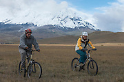 Antisana Volcano & cyclists<br /> 5,753 meters high or 18,874 ft<br /> Avenue of the Volcanoes<br /> Cordillera Real, Andes<br /> Condor Bioreserve as part of the Antisana Ecological Reserve<br /> ECUADOR, South America<br /> Last erupted between 1801 and 1802