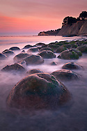 Geological concretions at dawnm Bowling Ball Beach, Mendocino County, California