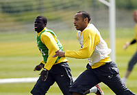 Photo: Chris Ratcliffe.<br />Arsenal Training Session. UEFA Champions League. 18/04/2006.<br />Thierry Henry and Emmanuel Eboue chase the ball during training