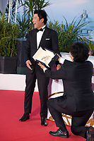Director Bong Joon-Ho winner of the Palme d'Or award for the film Parasite with Actor Kang-Ho Song at the Palme D'Or Award photo call at the 72nd Cannes Film Festival, Saturday 25th May 2019, Cannes, France. Photo credit: Doreen Kennedy