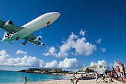Maho Beach. Plane watchers welcome an Air France Airbus 340 from Paris landing at Juliana Airport.