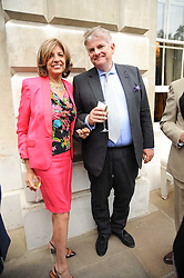 VIMLA LALVANI and SIR RICHARD OSBOURNE at a party to celebrate the 250th anniversary of the Colnaghi Gallery held at Spencer House, London on 1st July 2010.