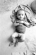 Baby boy on floor in small village home