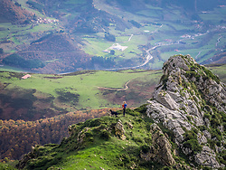 View of girl and pet dog on hiking tour in Picos de Europa