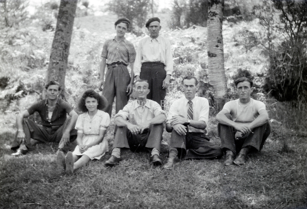 various generations family male group with one young girl posing rural 1950s